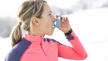 female runner with asthma inhaler